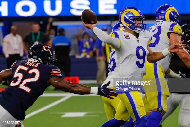 Chicago Bears outside linebacker Khalil Mack applies pressure to Los Angeles Rams quarterback Matthew Stafford , who threw a touchdown to Los Angeles...