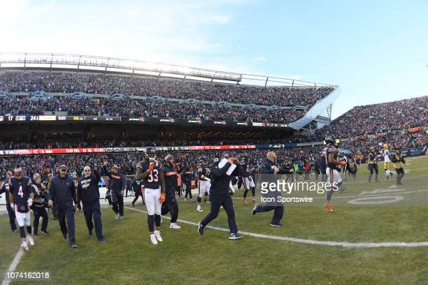 Chicago Bears players and coaching staff run onto the field after the game between the Green Bay Packers and the Chicago Bears on December 16 2018 at...