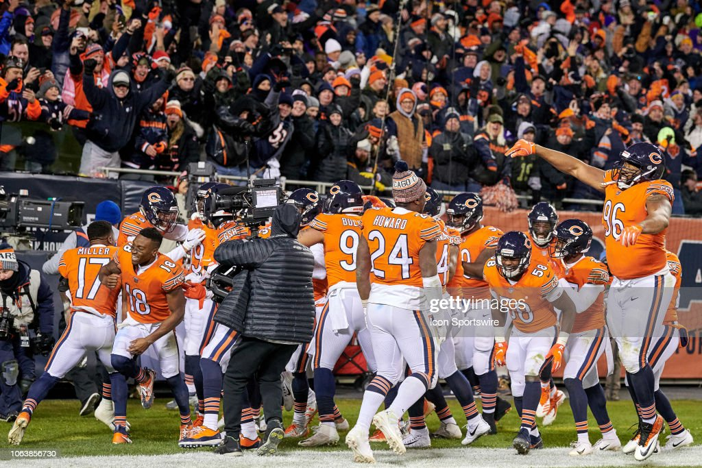 Chicago Bears players celebrate after a pick six by Chicago