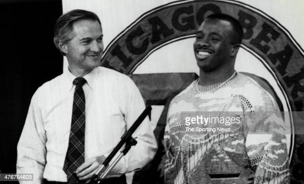 Chicago Bears President Michael McCaskey jokes with Bears running back Neal Anderson Friday in Chicago after the Bears announced they have signed...