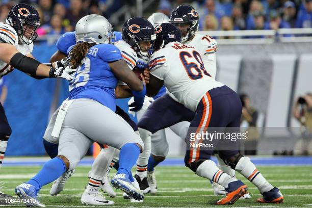 Chicago Bears quarterback Chase Daniel is sacked by Detroit Lions defensive tackle Damon Harrison amd Detroit Lions defensive end Romeo Okwara during...