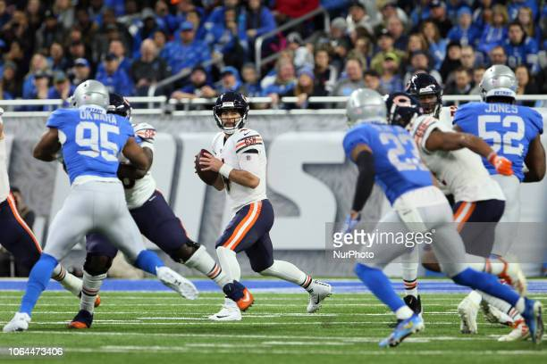 Chicago Bears quarterback Chase Daniel looks to pass the ball during the first half of an NFL football game against the Detroit Lions in Detroit...