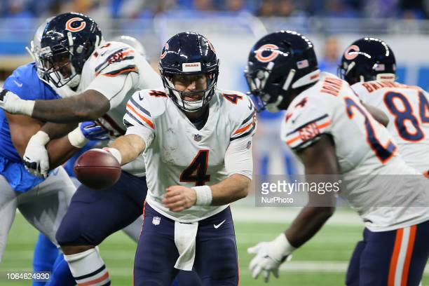 Chicago Bears quarterback Chase Daniel prepares to hand of to Chicago Bears running back Jordan Howard during the second half of an NFL football game...