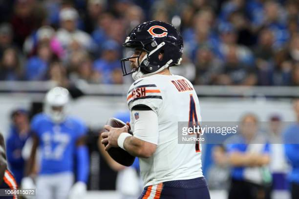 Chicago Bears quarterback Chase Daniel prepares to throw the ball during the first half of an NFL football game against the Detroit Lions in Detroit...
