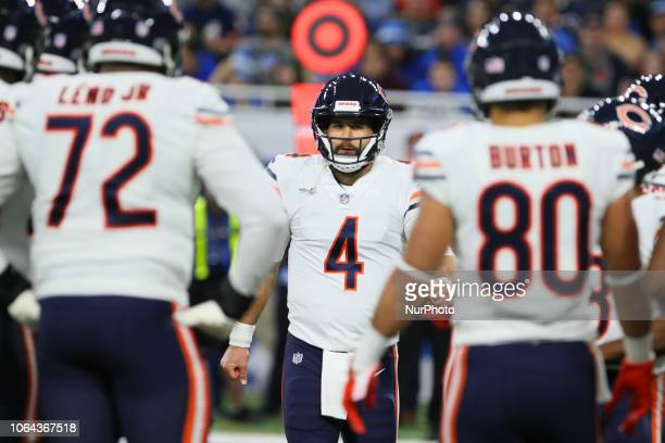 Chicago Bears quarterback Chase Daniel talks with teammates before a play during the first half of an NFL football game against the Chicago Bears in...