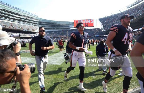 Chicago Bears quarterback Justin Fields runs off the field after a victory over the Cincinnati Bengals at Soldier Field in Chicago on Sunday,...