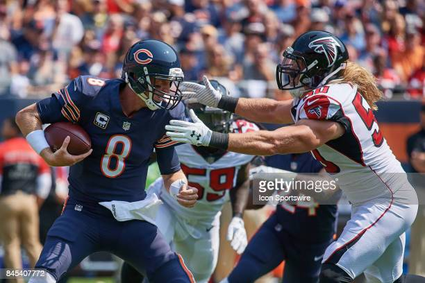 Chicago Bears quarterback Mike Glennon battles with Atlanta Falcons defensive end Brooks Reed during an NFL football game between the Atlanta Falcons...