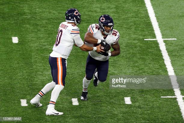 Chicago Bears quarterback Mitchell Trubisky hands the ball off to Chicago Bears running back David Montgomery during the first half of an NFL...