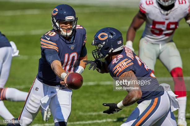 Chicago Bears quarterback Mitchell Trubisky hands the football to Chicago Bears running back David Montgomery in action during a game between the...