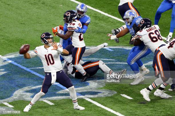 Chicago Bears quarterback Mitchell Trubisky looks to pass during the second half of an NFL football game against the Detroit Lions in Detroit,...