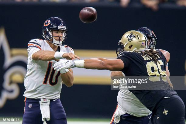 Chicago Bears quarterback Mitchell Trubisky passes against New Orleans Saints defensive tackle Tyeler Davison during the game between between the...