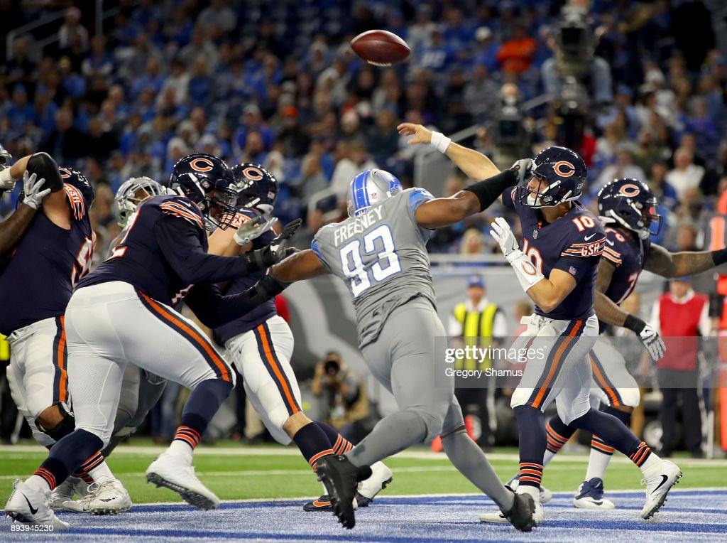 Chicago Bears quarterback Mitchell Trubisky #10 passes out of the end zone against the Detroit Lions at Ford Field on December 16, 2017 in Detroit, Michigan.