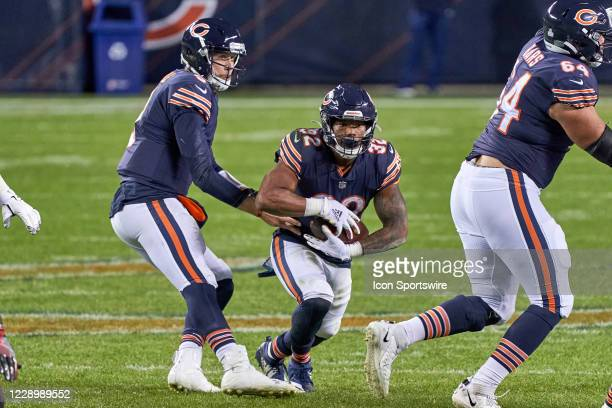 Chicago Bears Quarterback Nick Foles handles the football to Chicago Bears Running Back David Montgomery in game action during a NFL game between the...