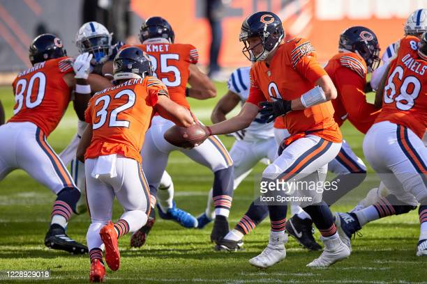 Chicago Bears Quarterback Nick Foles hands the football to Chicago Bears Running Back David Montgomery in game action during a NFL game between the...