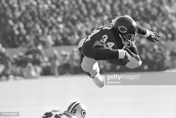 Chicago Bears' RB Walter Payton goes over the Green Bay Packers' line like a missile for shot gain and a first down on the 7-yard line in the first...