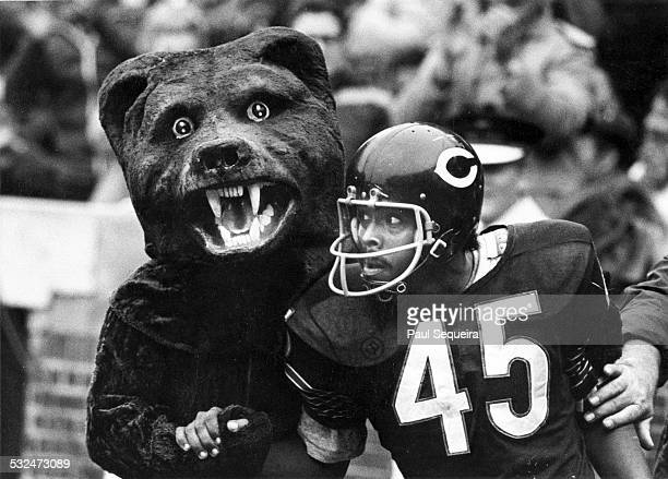 Chicago Bears receiver Dick Gordon celebrates a touchdown in the end zone with Bears volunteer mascot George Motyka during a game at Wrigley Field...