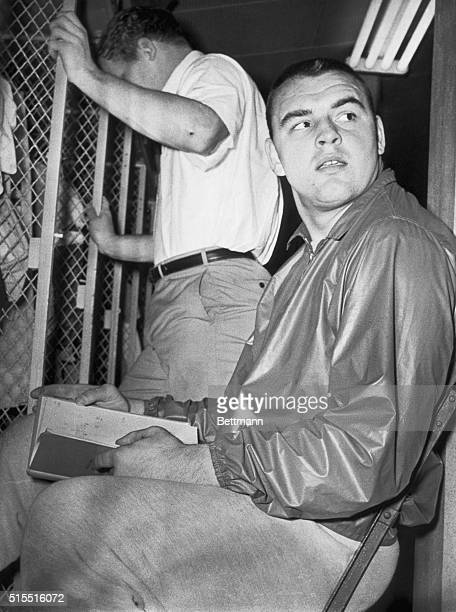 Chicago Bears rookie linebacker Dick Butkus looks up from a play book that he is studying here 12/8 in preparation for an all important NFL game...