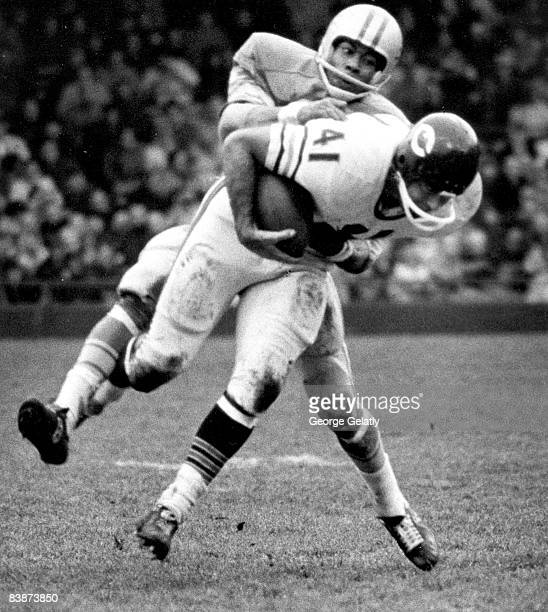 Chicago Bears running back Brian Piccolo is stopped by Lions Hall of Fame cornerback Lem Barney after catching a pass during the Bears 2713 victory...