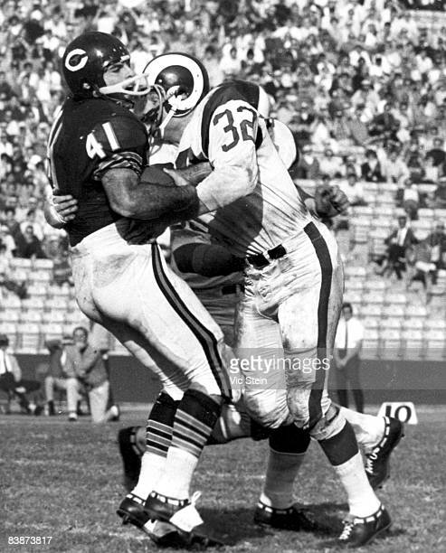 Chicago Bears running back Brian Piccolo takes a jarring hit from Rams linebacker Jack Pardee during the Bears 1716 victory over the Los Angeles Rams...