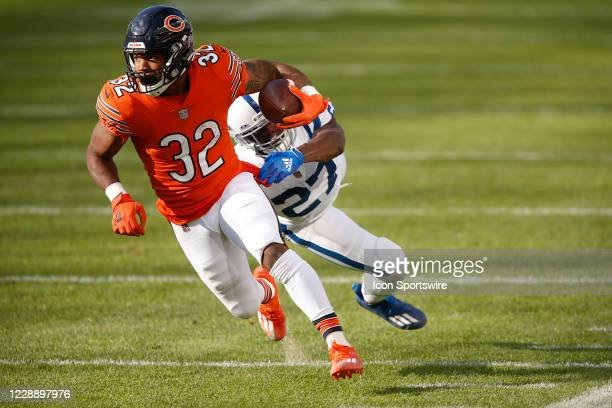 Chicago Bears Running Back David Montgomery avoids the tackle by Indianapolis Colts Cornerback Xavier Rhodes during the NFL football game between the...