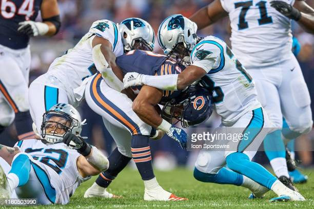 Chicago Bears running back David Montgomery battles with Carolina Panthers linebacker Antwione Williams and Carolina Panthers safety Rashaan Gaulden...