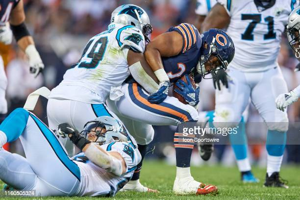 Chicago Bears running back David Montgomery battles with Carolina Panthers linebacker Antwione Williams in game action during a NFL preseason game...