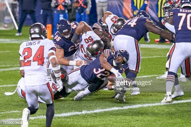 Chicago Bears Running Back David Montgomery battles with Chicago Bears Linebacker Roquan Smith to score a touchdown in game action during a NFL game...
