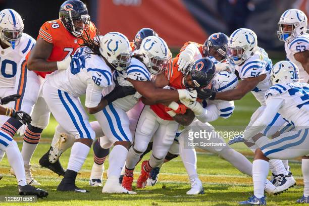 Chicago Bears Running Back David Montgomery battles with Indianapolis Colts Linebacker Anthony Walker Defensive Tackle DeForest Buckner Nose Tackle...