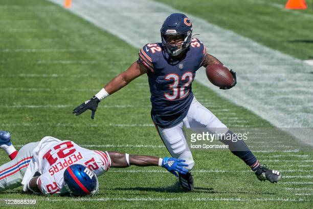 Chicago Bears running back David Montgomery battles with New York Giants strong safety Jabrill Peppers in action during a game between the Chicago...