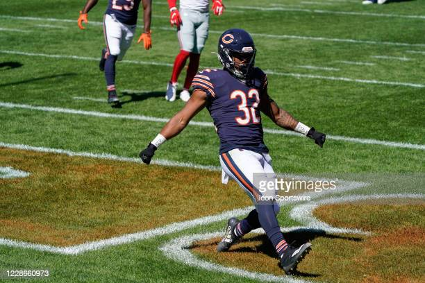 Chicago Bears running back David Montgomery celebrates after scoring a touchdown in action during a game between the Chicago Bears and the New York...
