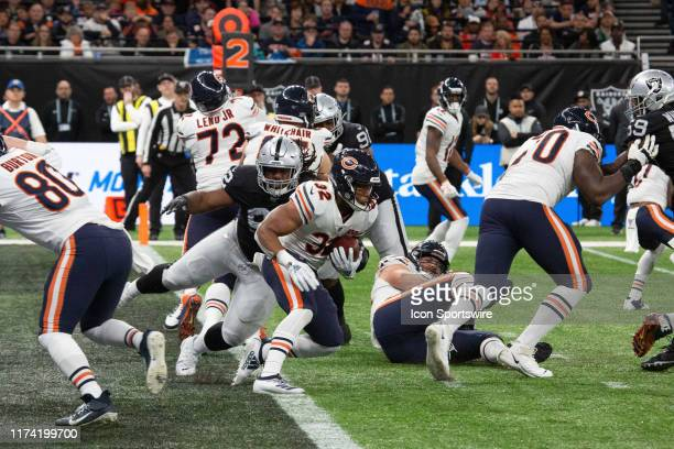Chicago Bears Running Back David Montgomery manages to get out of the end zone before a Chicago Bear defenseman tackles him during the game between...
