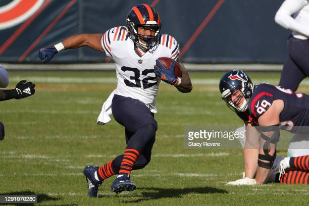 Chicago Bears running back David Montgomery runs against the Houston Texans during the second quarter at Soldier Field on December 13, 2020 in...