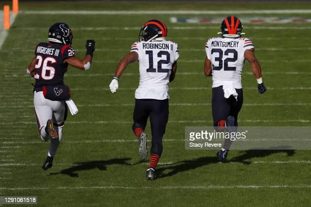 Chicago Bears running back David Montgomery runs for a touchdown as teammate Allen Robinson blocks Houston Texans cornerback Vernon Hargreaves III...
