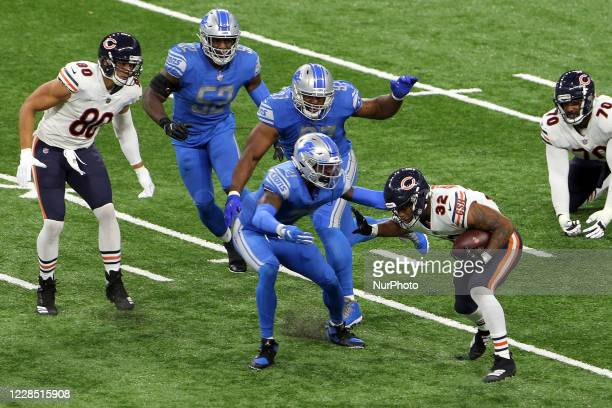 Chicago Bears running back David Montgomery runs the ball agains Detroit Lions defense during the second half of an NFL football game against the...