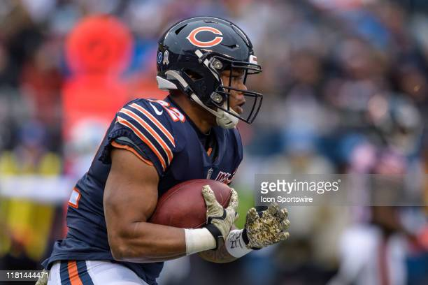 Chicago Bears Running Back David Montgomery runs the ball in the first quarter during an NFL football game between the Detroit Lions and the Chicago...