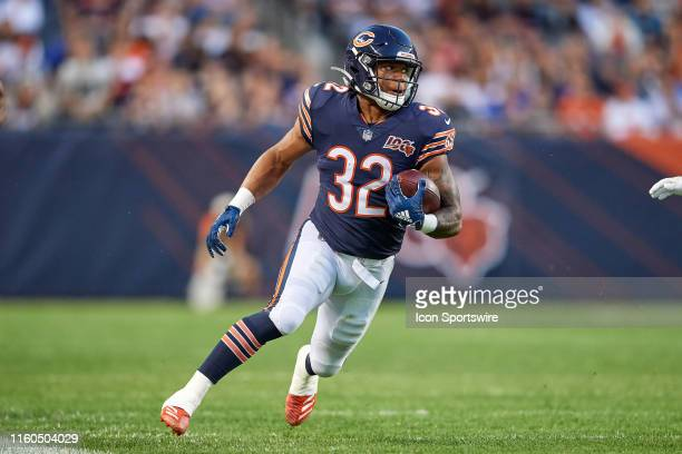 Chicago Bears running back David Montgomery runs with the football in game action during a NFL preseason game between the Carolina Panthers and the...