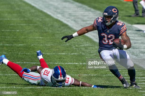 Chicago Bears running back David Montgomery runs with the football past New York Giants strong safety Jabrill Peppers in action during a game between...