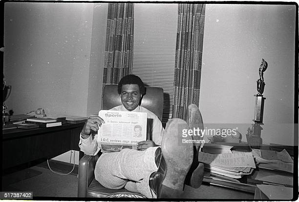 Chicago Bears' running back Gale Sayers a Chicago Park District Commissioner relaxes in his office 9/12 and reads a newspaper which tells of his...
