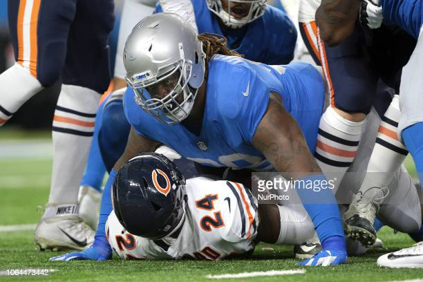 Chicago Bears running back Jordan Howard is tackled by Detroit Lions defensive tackle Damon Harrison during the first half of an NFL football game in...