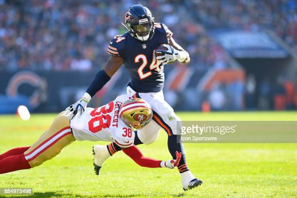 Chicago Bears running back Jordan Howard is tackled by San Francisco 49ers defensive back Adrian Colbert during the game between the Chicago Bears...