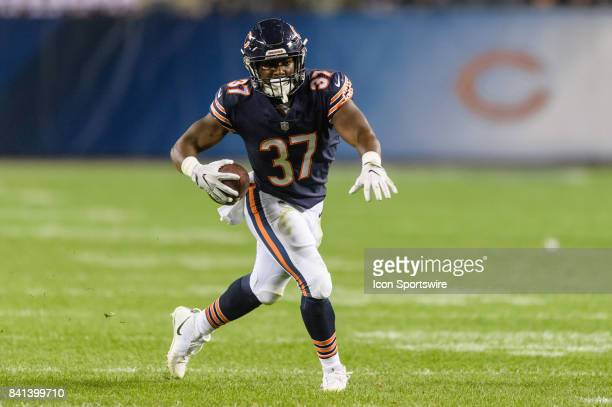 Chicago Bears running back Josh Rounds runs with the ball in the 4th quarter during an NFL preseason football game between the Cleveland Browns and...