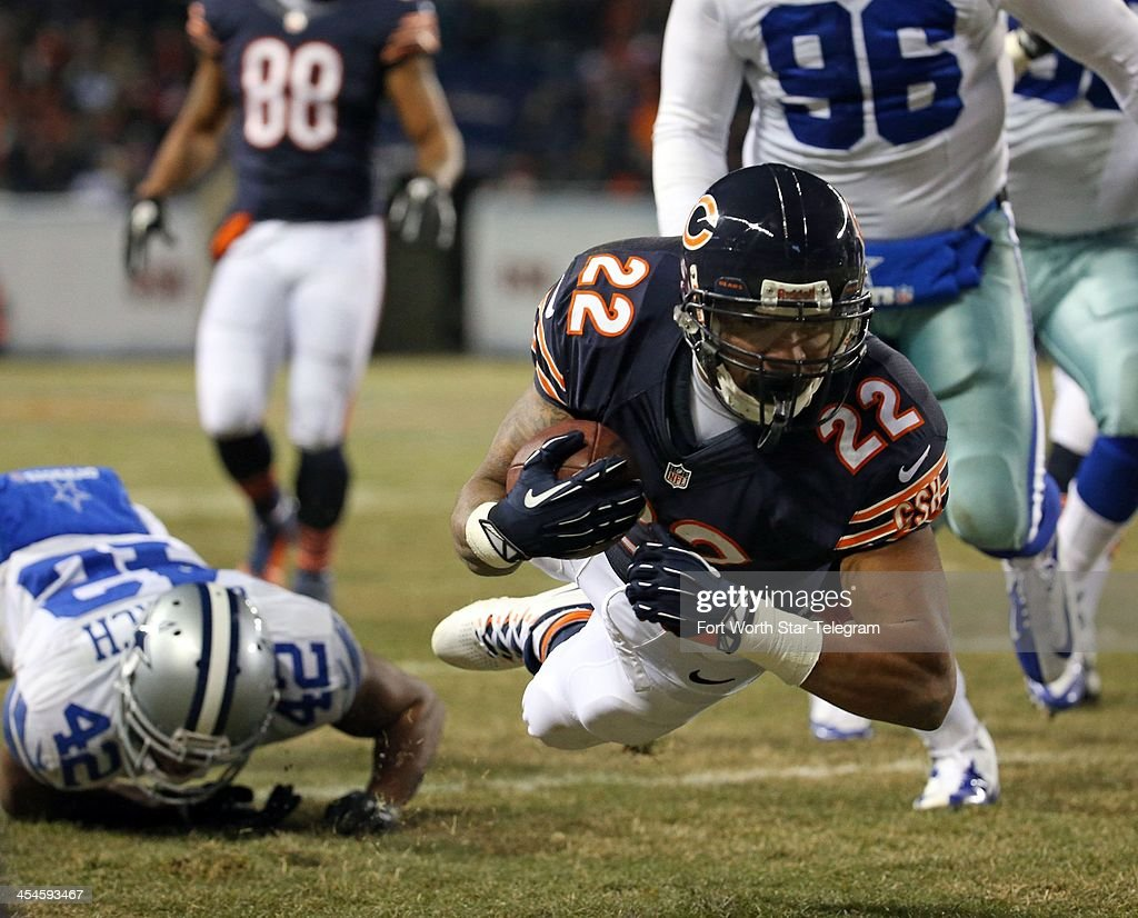 Chicago Bears running back Matt Forte (22) dives for yardage against the Dals Cowboys during the first quarter at Soldier Field on Monday, Dec. 9, 2013 in Chicago.