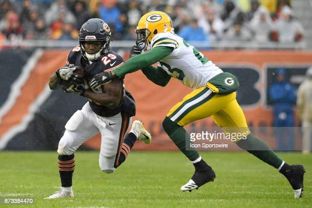 Chicago Bears running back Tarik Cohen battles with Green Bay Packers cornerback Damarious Randall during an NFL football game between the Green Bay...