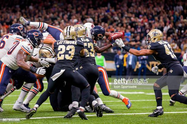 Chicago Bears running back Tarik Cohen dives over the left guard for a 1 yard touchdown during the game between between the Chicago Bears and the New...