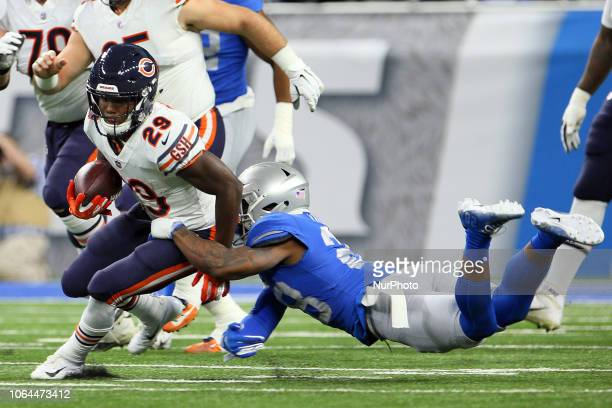 Chicago Bears running back Tarik Cohen is sacked by Detroit Lions strong safety Quandre Diggs during the first half of an NFL football game against...