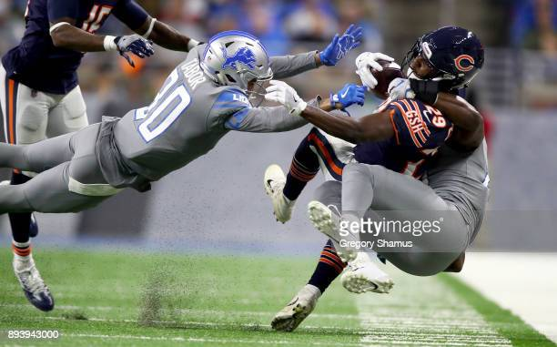 Chicago Bears running back Tarik Cohen is tackled by Detroit Lions cornerback Teez Tabor during the second half at Ford Field on December 16 2017 in...