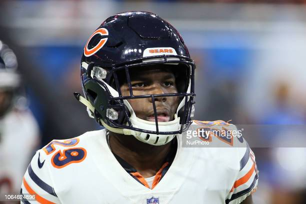 Chicago Bears running back Tarik Cohen runs off the field after scoring a touchdown during the second half of an NFL football game against the...