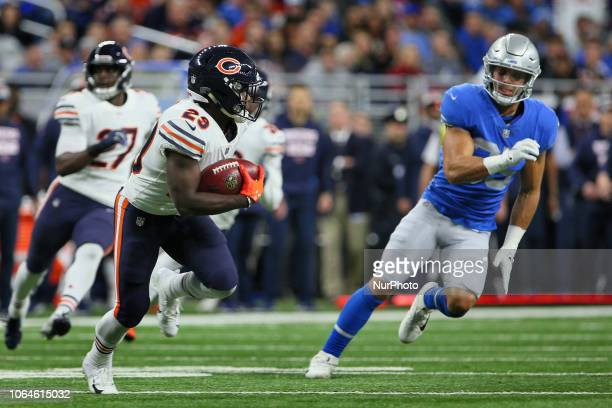 Chicago Bears running back Tarik Cohen runs the ball under the pressure of Detroit Lions defensive back Miles Killebrew during the first half of an...