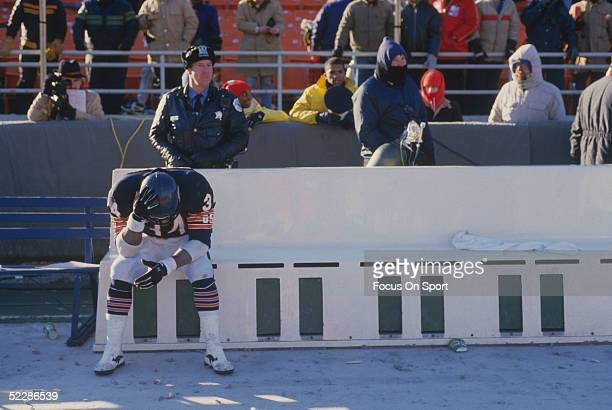 Chicago Bears' running back Walter Payton sits alone in a bench on the sidelines during a game circa 19751987