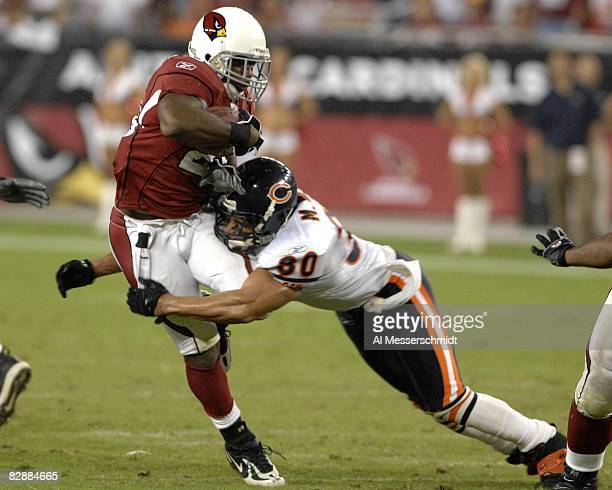 Chicago Bears safety Mike Brown tackles Arizona Cardinals running back J J Arrington Oct 16 2006 in Phoenix The Bears won 24 23 on Monday Night...